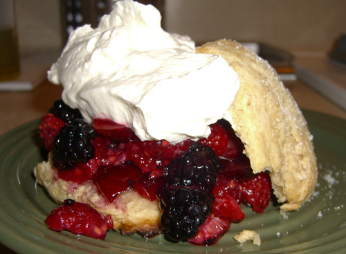 A fresh mixed berry buttermilk shortcake. Sorry, flash + whipped cream = crappy photo.